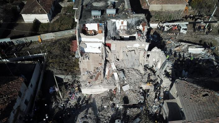 Rescuers search at a damaged building after a magnitude 6.4 earthquake in Thumane, western Albania, Tuesday, Nov. 26, 2019. (Photo: Hektor Pustina/AP)