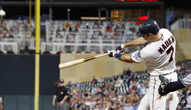 Minnesota Twins' Joe Mauer hits a grand slam off New York Yankees pitcher Tommy Kahnle in the fifth inning of a baseball game Tuesday, Sept. 11, 2018, in Minneapolis. (AP Photo/Jim Mone)