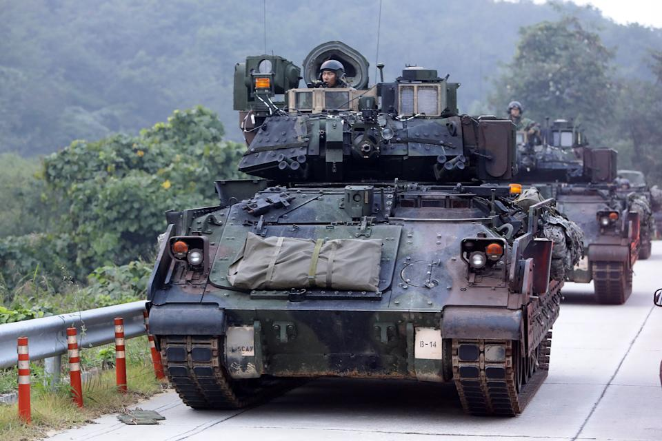 POCHEON, SOUTH KOREA - SEPTEMBER 19:  U.S. soldiers on M2 Bradley armored vehicles take part during the Warrior Strike VIII exercise at the Rodriguez Range on September 19, 2017 in Pocheon, South Korea. The United States 2ID (2nd Infantry Division) stationed in South Korea operates the exercise to improve defense capability from any invasion.  (Photo by Chung Sung-Jun/Getty Images)