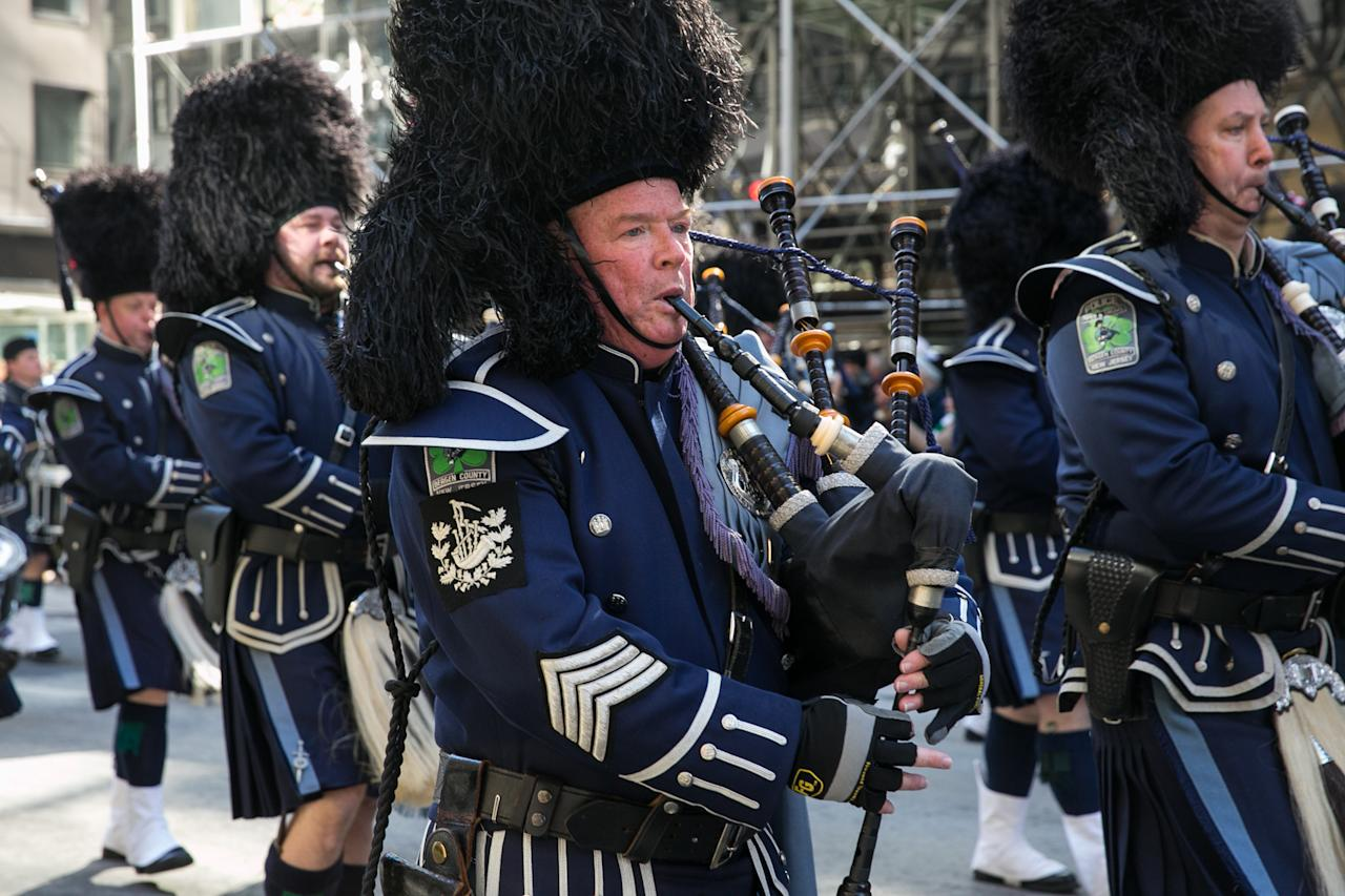 <p>The pipes were calling as the Wantagh Pipe Band marched down Fifth Avenue. (Photo: Casey Hollister/Yahoo Style) </p>
