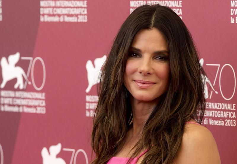 Actress Sandra Bullock poses for photographers at the photo call for the film Gravity during the 70th edition of the Venice Film Festival held from Aug. 28 through Sept. 7, in Venice, Italy, Wednesday, Aug. 28, 2013. (AP Photo/David Azia)