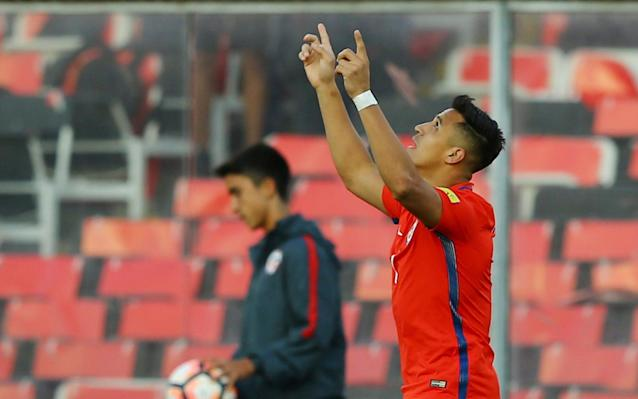 <span>Alexis Sanchez celebrates his goal against Venezuela as he becomes his country's joint top scorer</span> <span>Credit: Reuters </span>