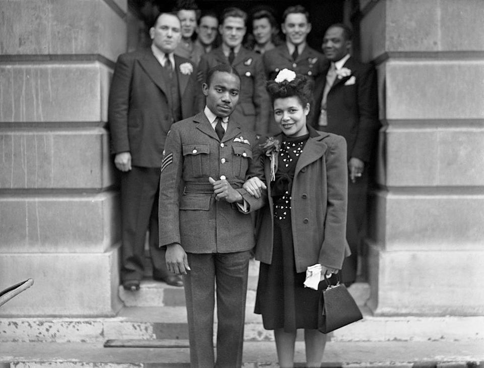 <p>Wartime weddings, such as this English couple's town hall ceremony, often saw the groom wearing his military uniform, while the bride donned her best dress in lieu of a gown. </p>