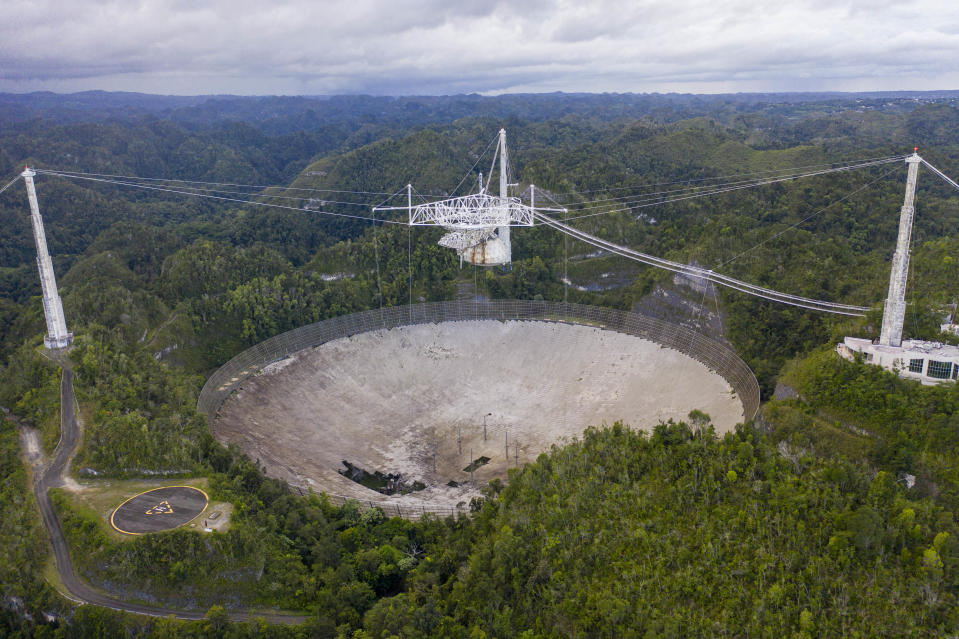 This aerial view shows a hole in the dish panels of the Arecibo Observatory in Puerto Rico, on November 19, 2020. (Photo by Ricardo Arduengo/AFP via Getty Images)