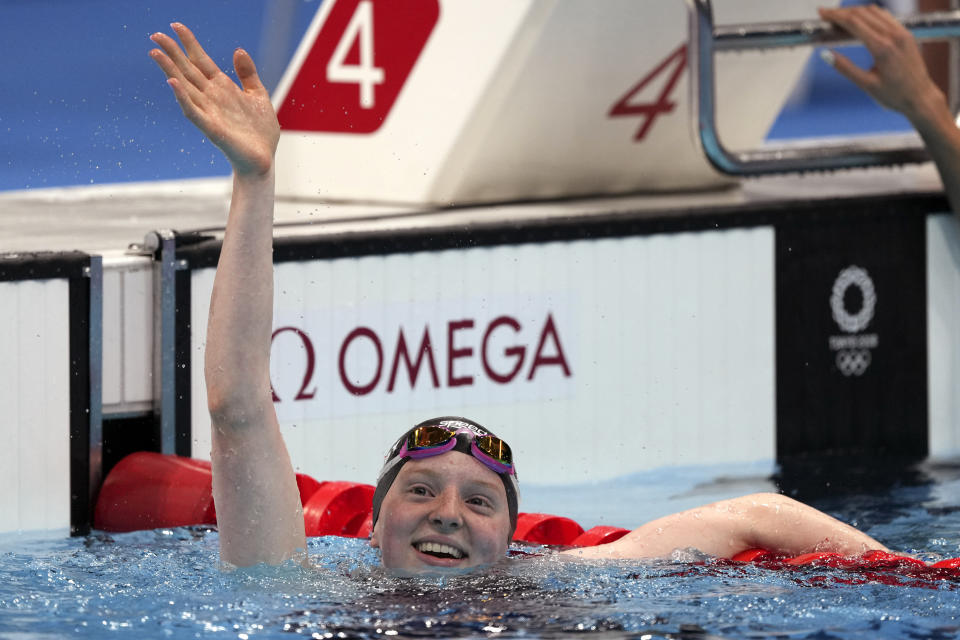 Lydia Jacoby of the United States waves after winning the final of the women's 100-meter breaststroke at the 2020 Summer Olympics, Tuesday, July 27, 2021, in Tokyo, Japan. (AP Photo/Matthias Schrader)