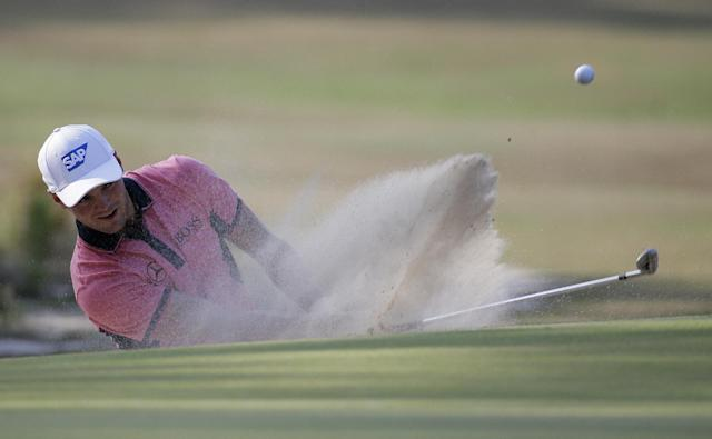 Martin Kaymer, of Germany, hits out of the bunker on the 10th hole during the third round of the U.S. Open golf tournament in Pinehurst, N.C., Saturday, June 14, 2014. (AP Photo/Eric Gay)