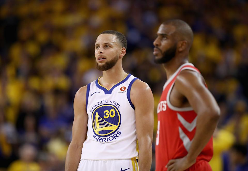 OAKLAND, CA - MAY 20:  Stephen Curry #30 of the Golden State Warriors stands next to Chris Paul #3 of the Houston Rockets during Game Three of the Western Conference Finals at ORACLE Arena on May 20, 2018 in Oakland, California. NOTE TO USER: User expressly acknowledges and agrees that, by downloading and or using this photograph, User is consenting to the terms and conditions of the Getty Images License Agreement.  (Photo by Ezra Shaw/Getty Images)