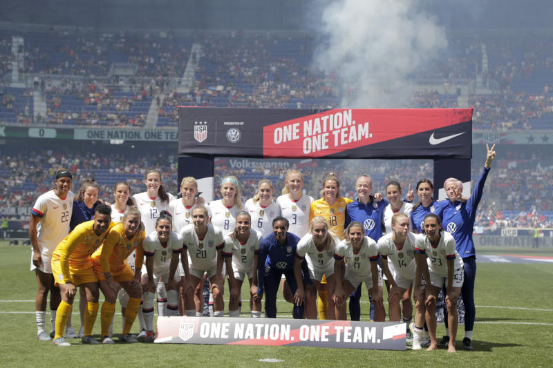 Members of the United States women's national team which is headed to the FIFA Women's World Cup, gather for fans during a send-off ceremony following an international friendly soccer match against Mexico, Sunday, May 26, 2019, in Harrison, N.J. (AP Photo/Julio Cortez)