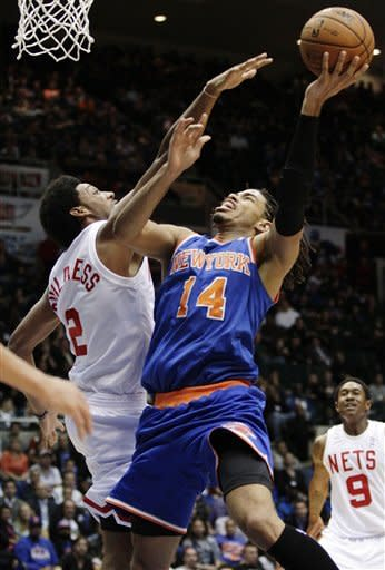 New York Knicks' Chris Copeland (14) shoots over Brooklyn Nets' Josh Childress (2) during the first half of a preseason NBA basketball game, Wednesday, Oct. 24, 2012, in Uniondale, N.Y. (AP Photo/Frank Franklin II)