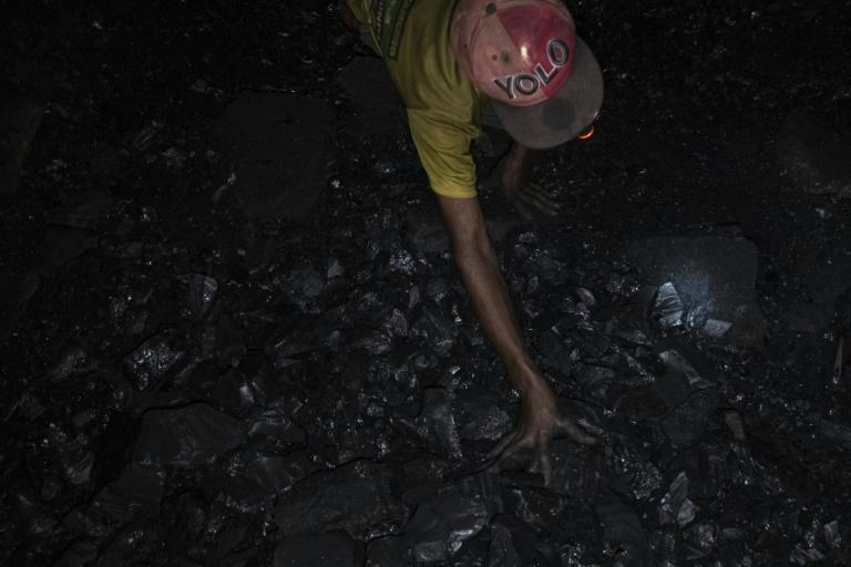 Miners manually hew coal and drag it up to the surface, where it sells for just $35 per tonne