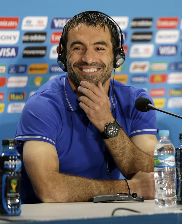 Greece's Giorgos Karagounis smiles to the media at a press conference on the day before the group C World Cup soccer match between Colombia and Greece at the Mineirao Stadium in Belo Horizonte, Brazil, Friday, June 13, 2014. (AP Photo/Fernando Vergara)