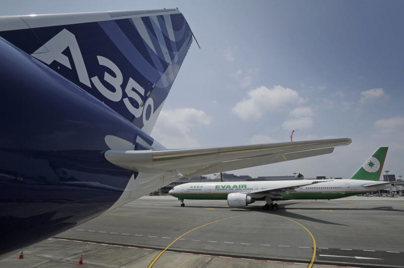 An Airbus A350-900 test plane is seen at Singapore's Changi Airport at a media preview ahead of the upcoming Singapore Air Show on Monday, Feb. 10, 2014. Airbus is showing off its new wide-body A350 at Asia's biggest airshow this week. It's a strong sign the European plane maker is on schedule to start delivering the advanced jet to airline customers in the second half of the year. (AP Photo/Joseph Nair)