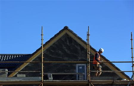 A construction worker carries out work on scaffolding at 'The Cedars' housing development site in the town of Swords situated on the outskirts of Dublin November 4, 2013. REUTERS/Cathal McNaughton