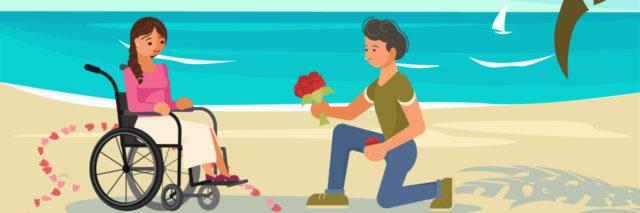 Man offering flowers to a woman in a wheelchair on the beach.