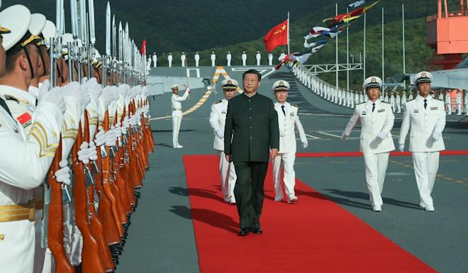 President Xi Jinping reviews the honour guard during the ceremony in Sanya last week. Photo: Xinhua