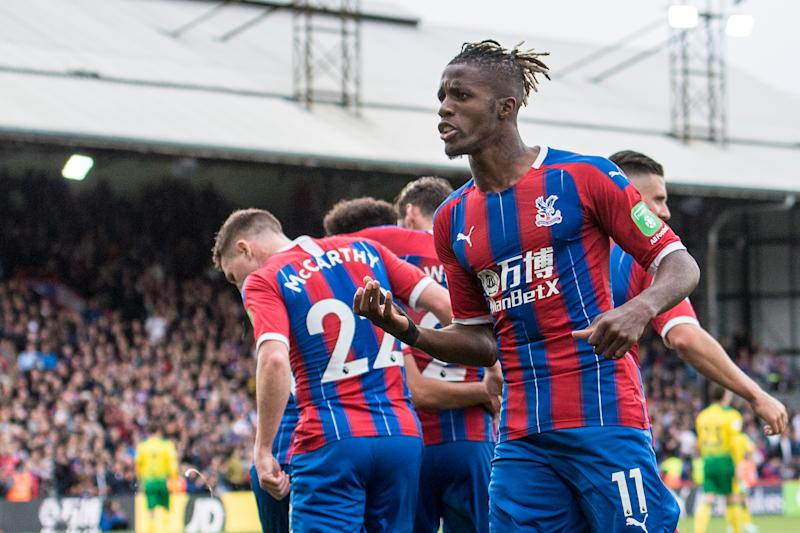 LONDON, ENGLAND - SEPTEMBER 28: Wilfried Zaha of Crystal Palace celebrate after Andros Townsend scoring goal during the Premier League match between Crystal Palace and Norwich City at Selhurst Park on September 28, 2019 in London, United Kingdom. (Photo by Sebastian Frej/MB Media/Getty Images)