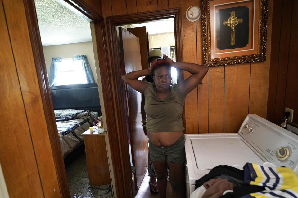 Patricia Bingo Lavergne reacts as she sees the inside of her damaged home for the first time in Lake Charles, La., after returning home after evacuating from Hurricane Laura, Sunday, Aug. 30, 2020. (AP Photo/Gerald Herbert)