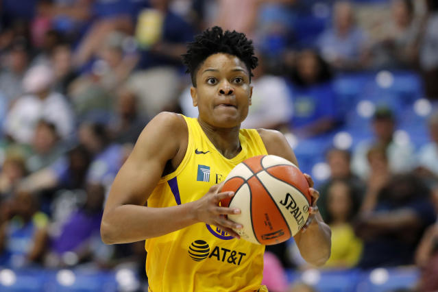 FILE - In this Aug. 14, 2019, file photo, Los Angeles Sparks' Alana Beard drives to the basket during a WNBA basketball game against the Dallas Wings in Arlington, Texas. Alana Beard, a two-time Defensive Player of the Year who won a WNBA championship with the Los Angeles Sparks, is retiring after 15 years. The Sparks announced her decision on Thursday, Jan. 23, 2020. (AP Photo/Tony Gutierrez, File)