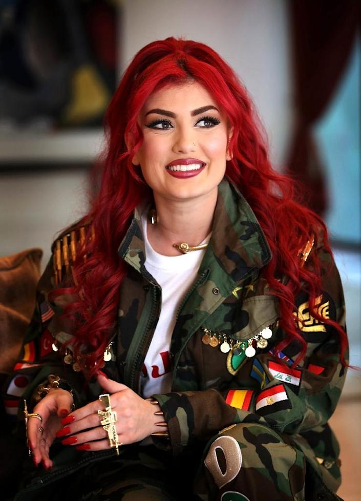In her new video, Helly Luv calls for Kurdistan and the countries of the world to unite to fight terrorism and injustice (AFP Photo/Safin Hamed)