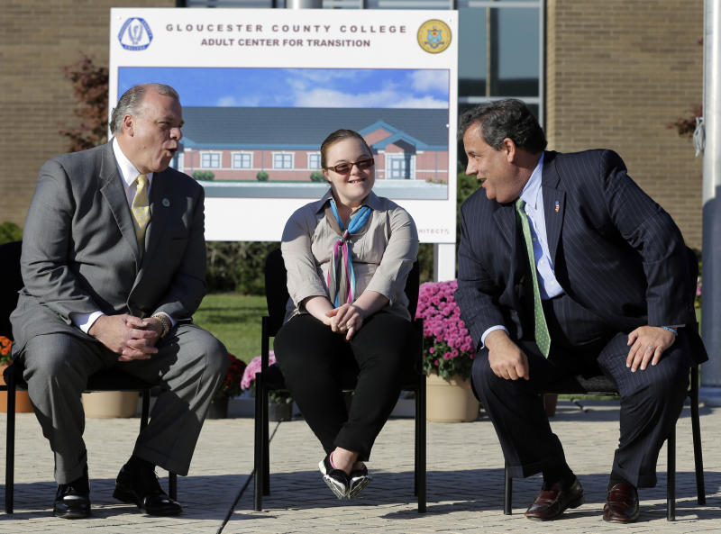 Lauren Sweeney sits between her father, New Jersey Senate President Stephen Sweeney, left, D-Thorofare, N.J., and New Jersey Gov. Chris Christie at Gloucester County College before they broke-ground on an adult center for transition facility at the school, in Sewell, N.J., Monday, Oct. 21, 2013. Earlier Monday, Christie dropped his appeal to legalized same-sex marriages in New Jersey. In an email, the governor's office says it submitted a formal withdrawal to the state Supreme Court Monday morning. Last month, a lower-court judge ruled that New Jersey must recognize gay marriages starting Monday. Gay couples began exchanging vows shortly after midnight. (AP Photo/Mel Evans)