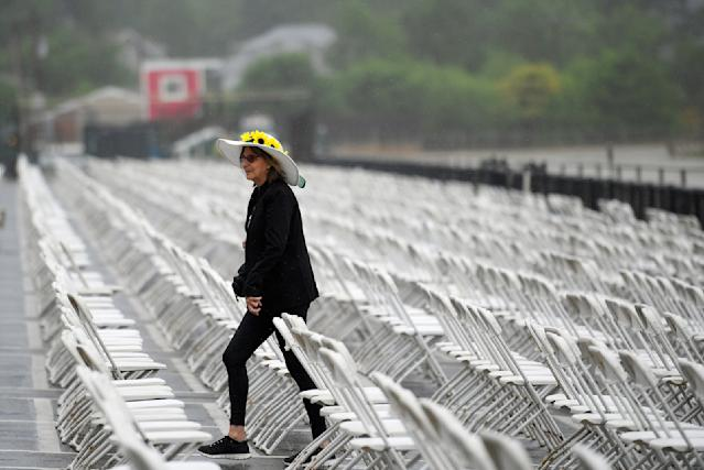 A racing fan walks in the seating area ahead of the 143rd Preakness Stakes horse race at Pimlico race course, Saturday, May 19, 2018, in Baltimore. (AP Photo/Nick Wass)