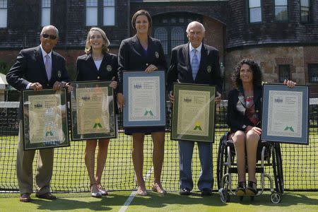 2014 inductees into the International Tennis Hall of Fame (L-R) coach Nick Bollettieri, WTA and USTA executive Jane Brown Grimes, former player Lindsay Davenport, tennis journalist and historian John Barrett and former wheelchair player Chantal Vandierendonck pose for a photograph after induction ceremonies in Newport, Rhode Island July 12, 2014. REUTERS/Brian Snyder