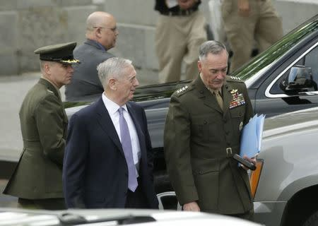 U.S. Defense Secretary Mattis and Joint Chiefs Chairman Dunford depart after briefing members of the U.S. Senate on North Korea at the White House in Washington