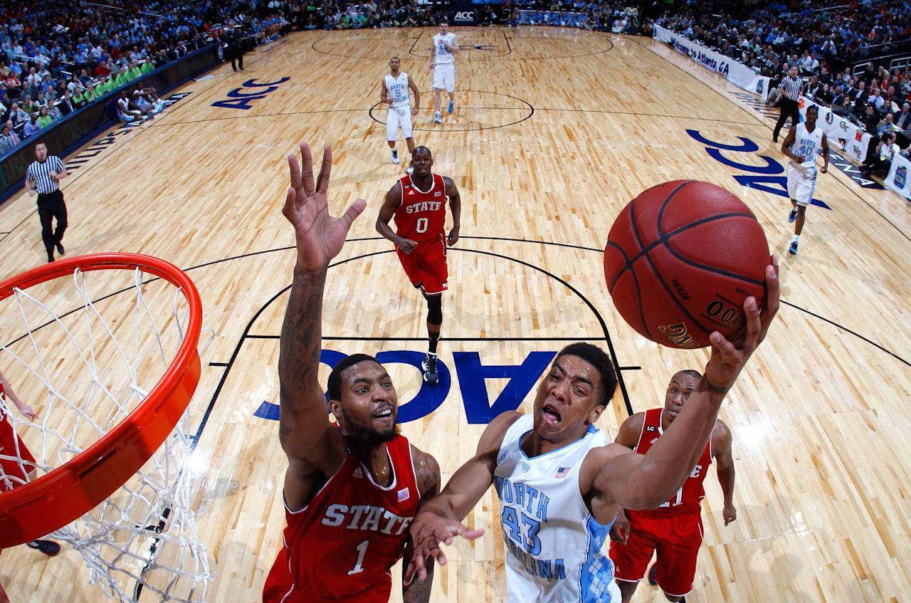 ATLANTA, GA - MARCH 10:  James Michael McAdoo #43 of the North Carolina Tar Heels drives against Richard Howell #1 of the North Carolina State Wolfpack during the semifinals of the 2012 ACC Men's Basketball Conference Tournament at Philips Arena on March 10, 2012 in Atlanta, Georgia.  (Photo by Kevin C. Cox/Getty Images)