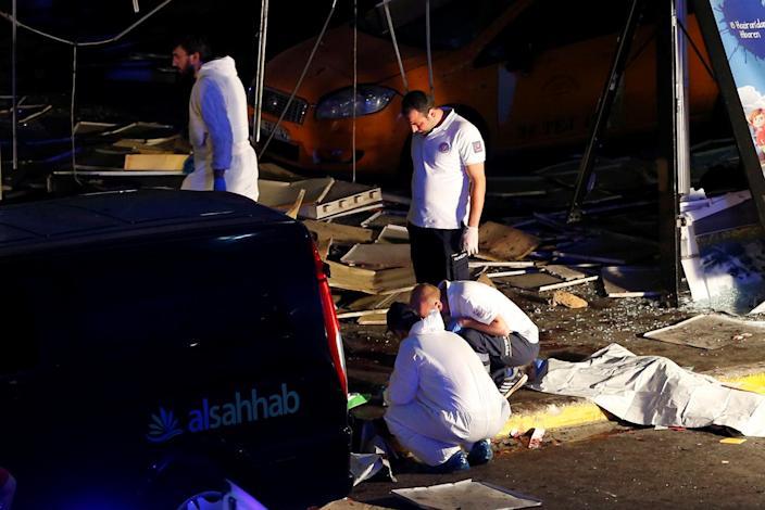 <p>Forensic experts work outside Turkey's largest airport, Istanbul Ataturk, Turkey, following a blast, June 28, 2016. (REUTERS/Murad Sezer) </p>