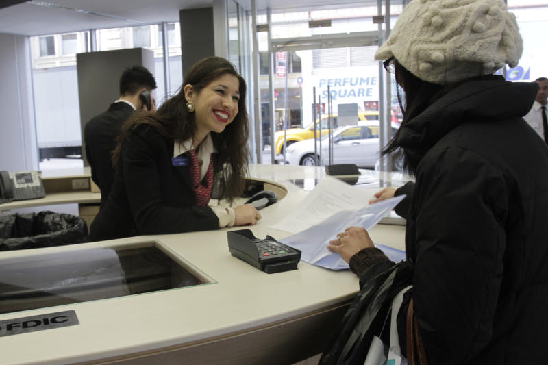 A Citibank employee helps a customer at Citibank's new high-tech banking center in New York's Union Square, Thursday, Dec. 16, 2010.  (AP Photo/Mary Altaffer)