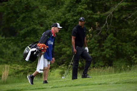 May 17, 2019; Bethpage, NY, USA; Tiger Woods and his caddie Joe LaCava on the fourth hole during the second round of the PGA Championship golf tournament at Bethpage State Park - Black Course. Mandatory Credit: Peter Casey-USA TODAY Sports