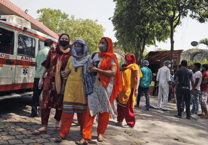 Relatives of a person who died of COVID- 19 leave after cremation in New Delhi, India, Monday, April 19, 2021. India's health system is collapsing under the worst surge in coronavirus infections that it has seen so far. Medical oxygen is scarce. Intensive care units are full. Nearly all ventilators are in use, and the dead are piling up at crematoriums and graveyards. Such tragedies are familiar from surges in other parts of the world — but were largely unknown in India. (AP Photo/Manish Swarup)