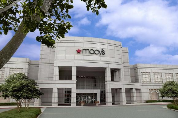 A Macy's store as seen from outside, with a tree in the foreground.