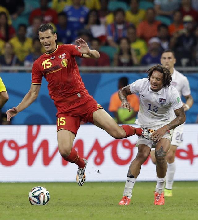 Belgium's Daniel Van Buyten is challenged by United States' Jermaine Jones during the World Cup round of 16 soccer match between Belgium and the USA at the Arena Fonte Nova in Salvador, Brazil, Tuesday, July 1, 2014. (AP Photo/Matt Dunham)