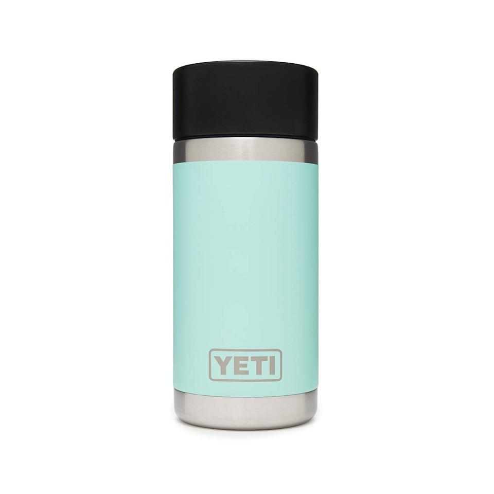 """<h2>YETI Rambler Bottle</h2><br><strong>Best For: Camping<br></strong>Just like the brand's <a href=""""https://www.yeti.com/en_US/coolers"""" rel=""""nofollow noopener"""" target=""""_blank"""" data-ylk=""""slk:famous coolers"""" class=""""link rapid-noclick-resp"""">famous coolers</a>, YETI travel mugs were made for outdoorsy folk. This thermos comes with a 100% leakproof cap, vacuum insulation, and is totally dishwasher safe.<br><br><em>Shop</em> <strong><em><a href=""""https://amzn.to/2Q8jbMg"""" rel=""""nofollow noopener"""" target=""""_blank"""" data-ylk=""""slk:YETI"""" class=""""link rapid-noclick-resp"""">YETI</a></em></strong><br><br><strong>YETI</strong> Rambler 12 oz Bottle, $, available at <a href=""""https://amzn.to/3hhBpWK"""" rel=""""nofollow noopener"""" target=""""_blank"""" data-ylk=""""slk:Amazon"""" class=""""link rapid-noclick-resp"""">Amazon</a>"""
