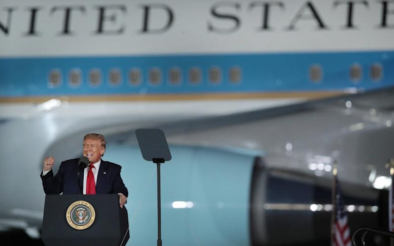 President Donald Trump speaks to supporters at a rally with Air Force One in the background in Freeland, Michigan - Scott Olson/Getty Images