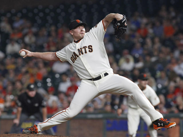 FILE - In this Aug. 31, 2017, file photo, San Francisco Giants pitcher Mark Melancon throws to the St. Louis Cardinals, during the eighth inning of a baseball game in San Francisco. Closer Mark Melancon will try to pitch a full season in the ninth inning after his disappointing first year in the Bay Area was cut short when he needed right forearm surgery in September. He made 32 appearances over 30 innings with 11 saves. (AP Photo/George Nikitin, File)