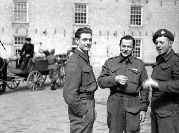 <p>Photographer: Grant, Donald I.<br /> Location: Leeuwarden, Netherlands,:<br /> Description: (L-R): Private P.E. Harter of the 1st Battalion, The Canadian Scottish Regiment; Private L.A. Hutchenson of The Essex Scottish Regiment; Corporal P.W. Tedball of The Algonquin Regime<br /> Date: April 16, 1945.<br /> Credit: Library and Archives Canada </p>