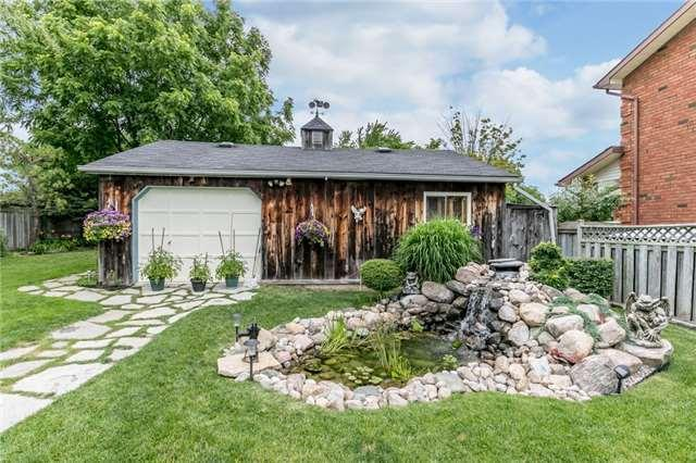 """<p><a href=""""https://www.zoocasa.com/barrie-on-real-estate/5276349-186-steel-st-barrie-on-l4m2g4-s4122163"""" rel=""""nofollow noopener"""" target=""""_blank"""" data-ylk=""""slk:186 Steel St., Barrie, Ont."""" class=""""link rapid-noclick-resp"""">186 Steel St., Barrie, Ont.</a><br> Outside you'll find a storage shed, pond, decks and a fully fenced yard.<br> (Photo: Zoocasa) </p>"""