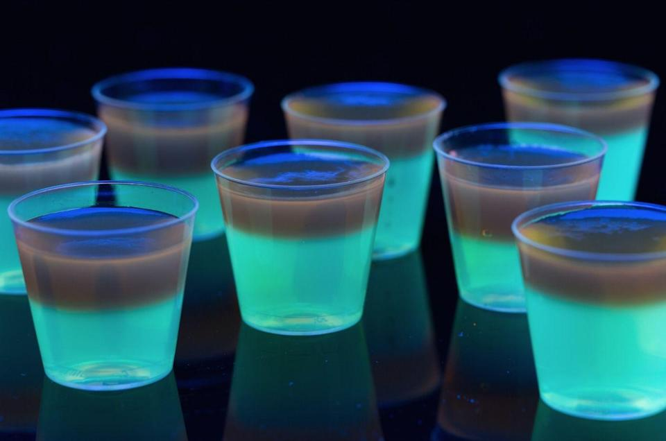 """<p>Nothing says """"paaaarty"""" like a Jell-O shot. Especially one that glows.</p><p>Get the recipe from <a href=""""https://www.delish.com/cooking/recipe-ideas/recipes/a44347/glowing-jell-o-shots-glow-party-foods/"""" rel=""""nofollow noopener"""" target=""""_blank"""" data-ylk=""""slk:Delish"""" class=""""link rapid-noclick-resp"""">Delish</a>.</p>"""
