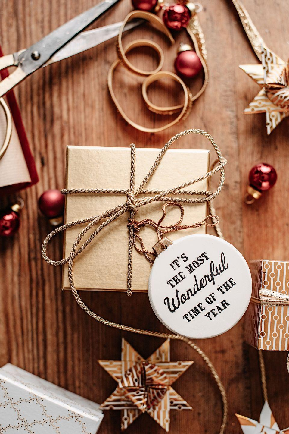"""<p>Only have plain packaging at your disposal? Seal the deal with a festive token they'll reach for year after year. </p><p><a class=""""link rapid-noclick-resp"""" href=""""https://www.amazon.com/Quarantine-Christmas-Ornaments-Quarantined-Distancing/dp/B08GZTZSTB?tag=syn-yahoo-20&ascsubtag=%5Bartid%7C10072.g.34015639%5Bsrc%7Cyahoo-us"""" rel=""""nofollow noopener"""" target=""""_blank"""" data-ylk=""""slk:SHOP ORNAMENT"""">SHOP ORNAMENT</a></p>"""