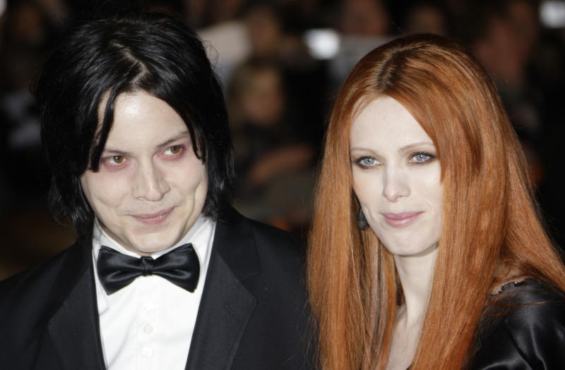 "FILE - In this Oct. 29, 2008 file photo, musician Jack White, left, and Karen Elson arrive on the red carpet for the Royal World Premiere of the 22nd James Bond film, ""Quantum of Solace"" in London. Elson filed a restraining order against White after she said in their divorce filings he was threatening her and she fears for her safety and her children's. Elson filed for a temporary restraining order July 17. It was approved by a judge pending a court hearing on Aug. 29. (AP Photo/Joel Ryan, file)"