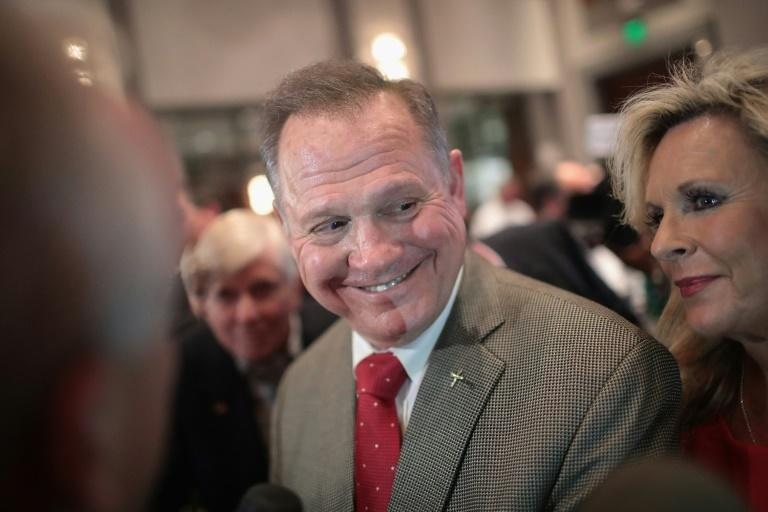 A woman has come forward in a Washington Post report to accuse Roy Moore, the Republican US Senate candidate from Alabama, of initiating sexual contact with her when she was 14 years old
