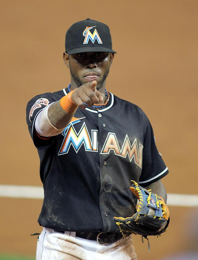 MIAMI, FL - APRIL 13: Shortstop Jose Reyes #7 of the Miami Marlins points to a fan during a game against the Houston Astros at Marlins Park on April 13, 2012 in Miami, Florida. (Photo by Marc Serota/Getty Images)