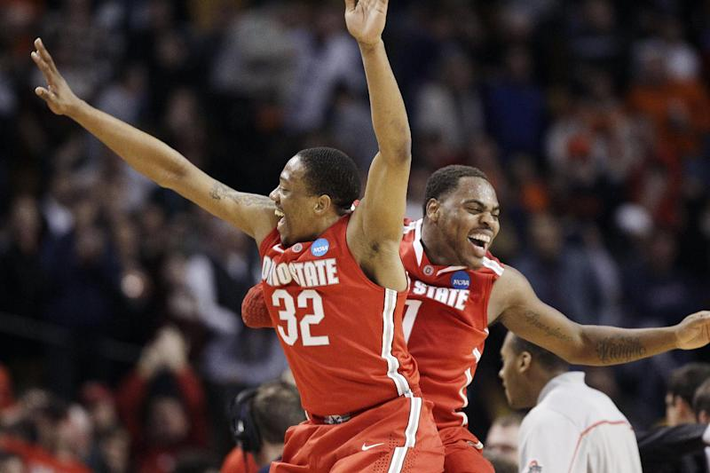 Ohio State's Lenzelle Smith, Jr. (32) and Deshaun Thomas (1) celebrate their team's 77-70 victory over Syracuse in the East Regional final game in the NCAA men's college basketball tournament, Saturday, March 24, 2012, in Boston. (AP Photo/Michael Dwyer)