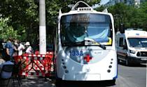 Bystanders gather near a trolleybus equipped with a vaccination station in Chisinau