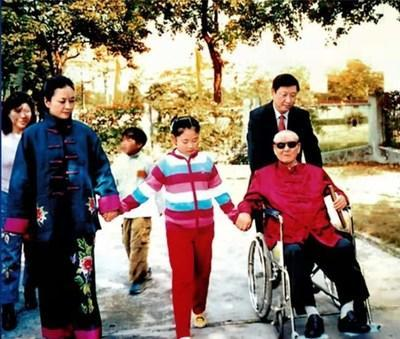 File photo of Xi Jinping (R, rear) with his father Xi Zhongxun (R, front), his wife Peng Liyuan (L, front) and his daughter (C, front). (PRNewsfoto/CCTV+)