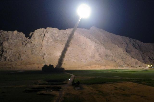 <p> In this picture released by the Iranian state-run IRIB News Agency on Monday, June 19, 2017, a missile is fired from city of Kermanshah in western Iran targeting the Islamic State group in Syria. Iran's powerful Revolutionary Guard, a paramilitary force in charge of the country's missile program, said it launched six Zolfaghar ballistic missiles from the western provinces of Kermanshah and Kurdistan. (IRIB News Agency, Morteza Fakhrinejad via AP) </p>