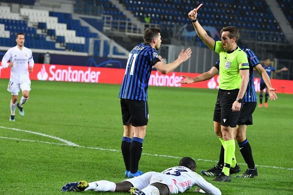 German referee Tobias Stieler gives a red card to Remo FreulerAFP