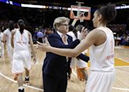 Tennessee head coach Holly Warlick, center, congratulates Cierra Burdick (11) after an NCAA women's college basketball second-round tournament game against St. John's Monday, March 24, 2014, in Knoxville, Tenn. Burdick led Tennessee with 21 points as they won 67-51. (AP Photo/Mark Humphrey)